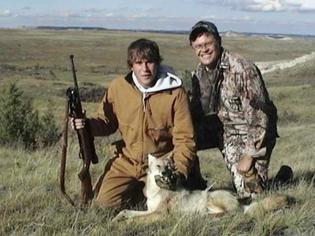 Chase and Dave with Chase's first coyote